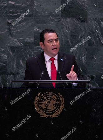 Stock Photo of Guatemalan President Jimmy Morales addresses the General Debate of the 74th session of the General Assembly of the United Nations at United Nations Headquarters in New York, New York, USA, 25 September 2019. The annual meeting of world leaders at the United Nations runs until 30 September 2019.