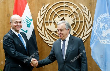 Stock Image of Iraq's President Barham Salih (L) shakes hands with United Nations Secretary-General Antonio Guterres at the start of a meeting on the sidelines of the General Debate of the 74th session of the General Assembly of the United Nations at United Nations Headquarters in New York, New York, USA, 25 September 2019. The annual meeting of world leaders at the United Nations runs until 30 September 2019.