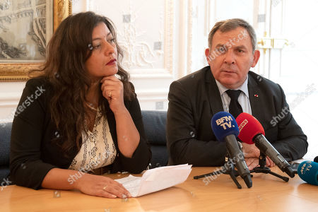 Sandra Muller (L), who created the hashtag #balancetonporc (rat on your pig), and Francis Szpiner (R), her lawyer, gives a press conference in Paris, France, 25 September 2019. Muller started a viral campaign in 2017 to encourage women to expose their sexual harassers. She was found guilty of defamation and ordered to pay 20,000 euros of damages to her ex-TV boss Eric Brion, on 25 September 2019, in Paris. Muller would appeal.