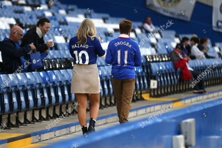 A couple of Chelsea fans arrive and head towards their seats, one wearing an Eden Hazard shirt and the other a Didier Drogba shirt during Chelsea vs Grimsby Town, Caraboa Cup Football at Stamford Bridge on 25th September 2019