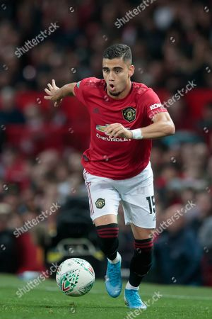 Manchester United midfielder Andreas Pereira takes the ball downfield