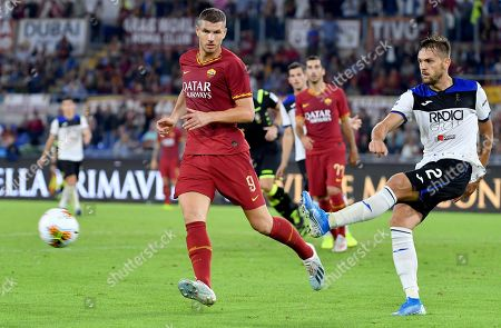 AS Roma's Edin Dzeko (L) vies for the ball with Atalanta's Rafael Toloi during the Italian Serie A soccer match between AS Roma and Atalanta at the Olimpico stadium in Rome, Italy, 25 September 2019.