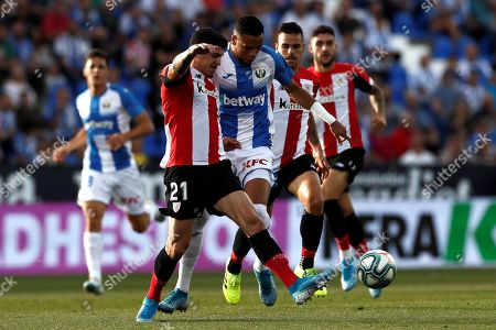 Leganes' Youssef En Nesyri (R) in action against Athletic's defender Ander Capa (L) during the Spanish LaLiga match between CD Leganes and Athletic Club de Bilbao at Butarque stadium in Leganes, Madrid, Spain, 25 September 2019.