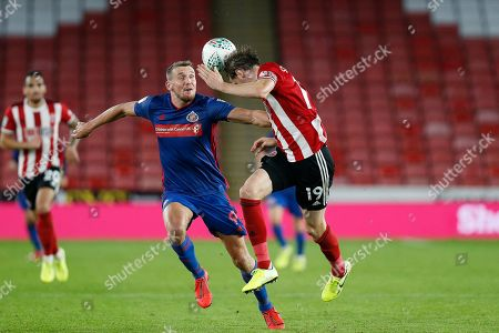 Richard Stearman of Sheffield United heads the ball away during the EFL Cup match between Sheffield United and Sunderland at Bramall Lane, Sheffield