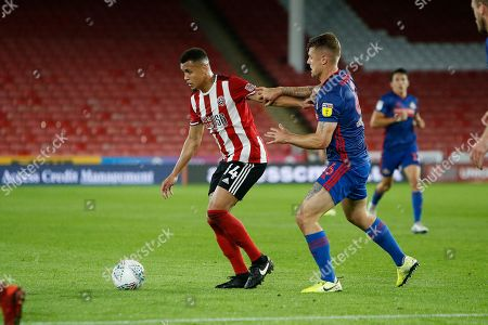 Ravel Morrison of Sheffield United holds off Max Power of Sunderland during the EFL Cup match between Sheffield United and Sunderland at Bramall Lane, Sheffield