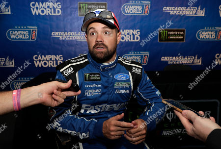 Ricky Stenhouse Jr., talks to media during a practice for the NASCAR Sprint Cup Series auto race at Chicagoland Speedway in Joliet, Ill. Ricky Stenhouse Jr. and Roush Fenway Racing will split at the end of the season and Chris Buescher will replace him in 2020. Although his contract is believed to run through 2021, the team said, it will part ways with the two-time Xfinity Series champion at the end of the year