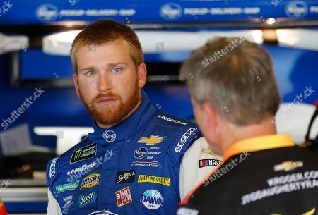Chris Buescher talks to his crew after a practice session for a NASCAR Cup series race at Michigan International Speedway, in Brooklyn, Mich. Ricky Stenhouse Jr. and Roush Fenway Racing will split at the end of the season and Chris Buescher will replace him in 2020. Although his contract is believed to run through 2021, the team said, it will part ways with the two-time Xfinity Series champion at the end of the year