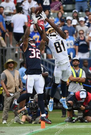 Mike Williams - Lonnie Johnson Jr. Los Angeles Chargers wide receiver Mike Williams (81) and Houston Texans cornerback Lonnie Johnson Jr. (32) go up for a pass thrown to the back of the end zone during an NFL game, in Carson, Calif. The Texans defeated the Chargers 27-20