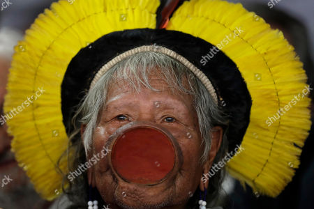 Brazilian indigenous chief Raoni Metuktire attends a meeting with lawmakers and other organizations in the House of Representatives, in Brasilia, Brazil, . The Kayapo chieftain has called for President Jair Bolsonaro to quit after he downplayed environmental threats in the Amazon rainforest, a day after Bolsonaro attacked Raoni personally during the U.N. General Assembly