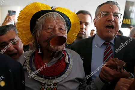 Brazilian indigenous chief Raoni Metuktire arrives to attend a meeting with lawmakers and other organizations in the House of Representatives, in Brasilia, Brazil, . The Kayapo chieftain has called for President Jair Bolsonaro to quit after he downplayed environmental threats in the Amazon rainforest, a day after Bolsonaro attacked Raoni personally during the U.N. General Assembly