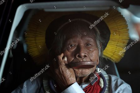 Brazilian indigenous chief Raoni Metuktire arrives in a car to meet with lawmakers and other organizations at the House of Representatives, in Brasilia, Brazil, . The Kayapo chieftain has called for President Jair Bolsonaro to quit after he downplayed environmental threats in the Amazon rainforest, a day after Bolsonaro attacked Raoni personally during the U.N. General Assembly