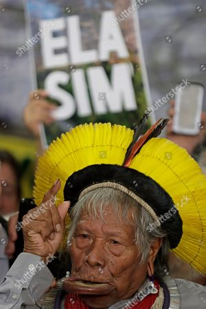 Brazilian indigenous chief Raoni Metuktire speaks to the press before a meeting with lawmakers and other organizations in the House of Representatives, in Brasilia, Brazil, . The Kayapo chieftain has called for President Jair Bolsonaro to quit after he downplayed environmental threats in the Amazon rainforest, a day after Bolsonaro attacked Raoni personally during the U.N. General Assembly