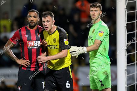 Stock Picture of Bournemouth forward Callum Wilson and Burton Albion defender Kieran Wallace during the EFL Cup match between Burton Albion and Bournemouth at the Pirelli Stadium, Burton upon Trent