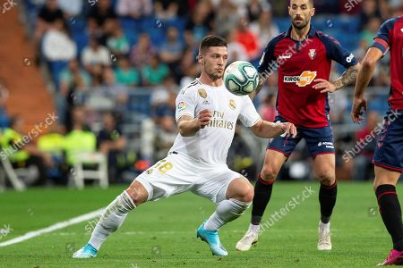 Real Madrid's forward Luka Jovic (C) in action against Osasuna's defender Lillo (R) during the Spanish LaLiga match between Real Madrid and CA Osasuna at Santiago Bernabeu stadium in Madrid, Spain, 25 September 2019.