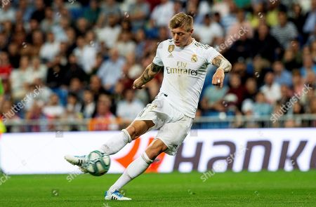 Real Madrid's midfielder Toni Kroos in action during the Spanish LaLiga match between Real Madrid and CA Osasuna at Santiago Bernabeu stadium in Madrid, Spain, 25 September 2019.