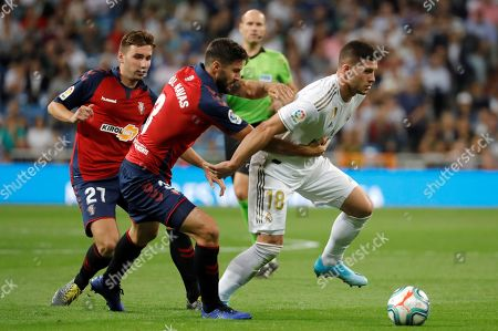 Real Madrid's forward Luka Jovic (R) in action against Osasuna's defender Raul Navas (C) during the Spanish LaLiga match between Real Madrid and CA Osasuna at Santiago Bernabeu stadium in Madrid, Spain, 25 September 2019.