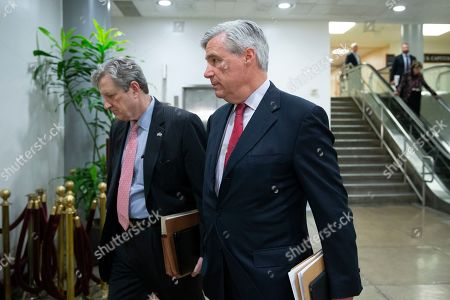 Stock Photo of Republican Senator from Louisiana John Kennedy (L) and Democratic Sentator from Rhode Island Sheldon Whitehouse (R) head to a closed intelligence briefing for US senators on the subject of Iran, on Capitol Hill in Washington, DC, USA, 25 September 2019.