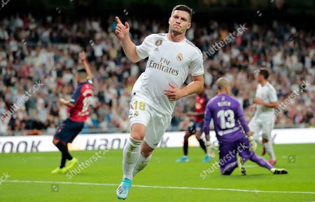 Real Madrid's Luka Jovic celebrates a goal chalked off due to a correct offside call, during the Spanish La Liga soccer match between Real Madrid and Osasuna at the Santiago Bernabeu stadium in Madrid, Spain
