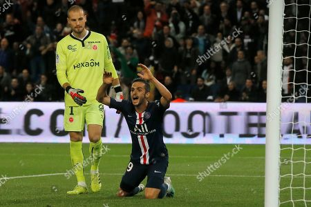 Stock Picture of PSG's Pablo Sarabia, center, complains he was faulted and Reims' goalkeeper Predrag Rajkovic looks on during the French League One soccer match between PSG and Reims at the Parc des Princes stadium in Paris