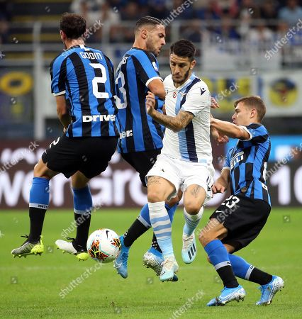 Lazio's Luis Alberto (2R) challenges for the ball with (L-R) Inter's Diego Godin, Danilo D'Ambrosio and Nicolo Barella during the Italian serie A soccer match between FC Inter and SS Lazio at Giuseppe Meazza stadium in Milan, Italy, 25 September 2019.