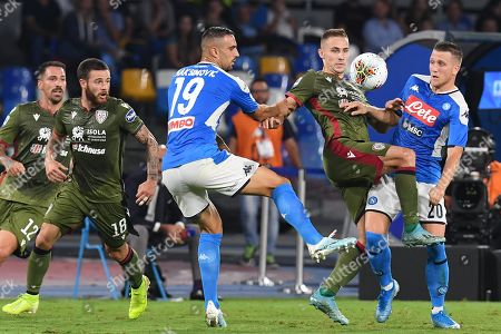 Napoli players Nikola Maksimovic (L) and Piotr Zielinski (R) in action against Marko Rog (C) of Cagliari during the Italian Serie A match between SSC Napoli and Cagliari Calcio  t the San Paolo stadium in Naples, 25 September 2019.
