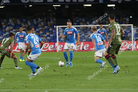 Napoli's midfielder Piotr Zielinski (C) in action during the Italian Serie A match between SSC Napoli and Cagliari Calcio at the San Paolo stadium in Naples, 25 September 2019.