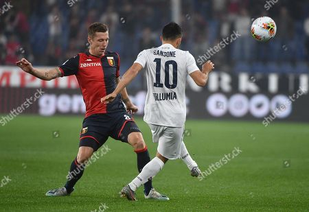 Stock Image of Genoa's Lukas Lerager (L) and Bologna's Nicola Sansone in action during the Italian Serie A soccer match Genoa CFC vs Bologna FC at the Luigi Ferraris stadium in Genoa, Italy, 25 September 2019.