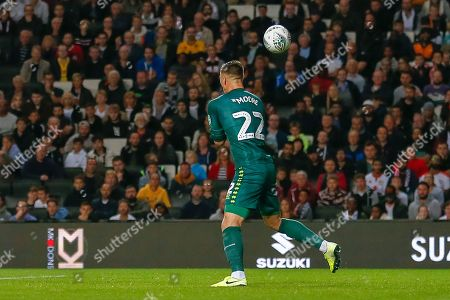 GOAL 0-1 Milton Keynes Dons goalkeeper Stuart Moore (22) makes a fumble and lets in the strike from Liverpool midfielder James Milner (7) (not in picture) during the EFL Cup match between Milton Keynes Dons and Liverpool at stadium:mk, Milton Keynes