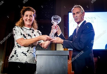 Stock Photo of Belgian theater director Ivo van Hove (R) receives the Johannes Vermeer Prize 2019, the Dutch state prize for the arts, from Dutch Minister of Education, Culture and Science Ingrid van Engelshoven (L) in The Hague, the Netherlands, 25 September 2019.