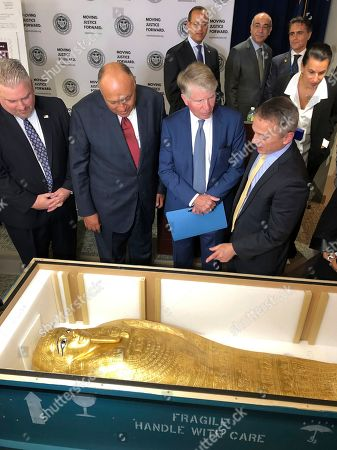 Peter Fitzhugh, Hassan Shoukry, Cyrus Vance Jr., Matthew Bogdanos. U.S. Homeland Security Investigations special-agent-in-charge Peter Fitzhugh, left, Egyptian Minister of Foreign Affairs Hassan Shoukry center left, Manhattan District Attorney Cyrus Vance Jr., center right and Assistant District Attorney Matthew Bogdanos view the Coffin of Nedjemankh at a repatriation ceremony in New York, . The coffin, featured at New York's Metropolitan Museum of Art until it was determined to be a looted antiquity, is on its way back to Egypt