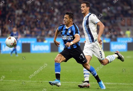 Inter's Alexis Sanchez (L) vies for the ball with Lazio's Luiz Felipe during the Italian Serie A soccer match between FC Inter and SS Lazio at Giuseppe Meazza stadium in Milan, Italy, 25 September 2019.