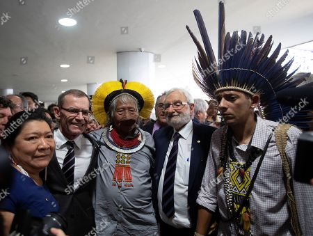Stock Photo of Cacique Raoni Metuktire (C), a historic defender of the rights of indigenous peoples of the Amazon, participates in an event held at the Congress, in Brasilia, Brazil, 25 September 2019, a day after the president of Brazil, Jair Bolsonaro, before The General Assembly of the United Nations accused him of being 'used by foreign powers' who would pretend to take over that region. Metuktire said that Bolsonaro 'is not a leader and must leave the power', for 'the good of all'.