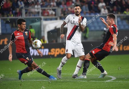 Bologna player Roberto Soriano (C) in action against Genoa's Lukas Lerager (R) and Cristian Romero during the Italian Serie A soccer match between Genoa CFC and Bologna FC at the Luigi Ferraris stadium in Genoa, Italy, 25 September 2019.