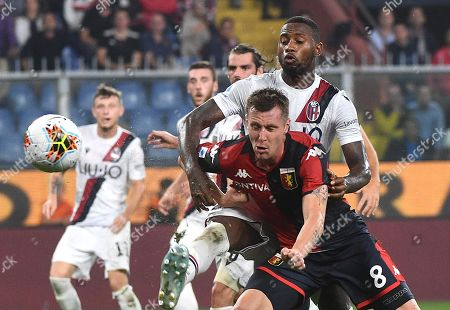 Genoa's Lukas Lerager (front) and Bologna's Stefano Denswil in action during the Italian Serie A soccer match between Genoa CFC and Bologna FC at the Luigi Ferraris stadium in Genoa, Italy, 25 September 2019.