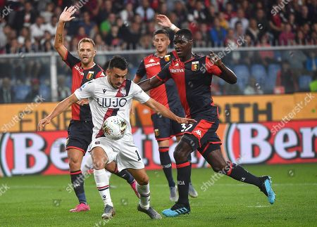 Stock Photo of Genoa's Cristian Zapata (R) and Bologna's Nicola Sansone in action during the Italian Serie A soccer match between Genoa CFC and Bologna FC at the Luigi Ferraris stadium in Genoa, Italy, 25 September 2019.