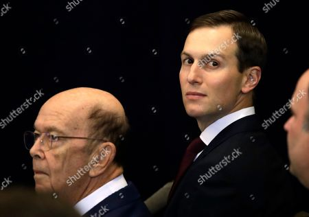 Secretary of Commerce Wilbur Ross (L) and White House senior advisor Jared Kushner sit in the audience before the start of a press conference with US President J. Donald Trump being held on the sidelines of the opening of the 74th session of the United Nations General Assembly in New York, New York, USA, 25 September 2019. Democrats in the United States Congress announced they are beginning a formal impeachment inquiry as a result of a President Trump's actions on a phone call with the president of Ukraine.