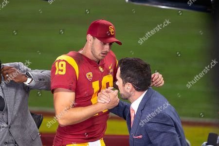 Los Angeles, CA...USC quarterback (19) Matt Fink gets congratulated by former USC quarterback Matt Leinart after a game between the Utah Utes vs USC Trojans. USC defeated Utah 30-23 on at the United Airlines Field at the Los Angeles Memorial Coliseum, in Los Angeles, California. (Mandatory Credit: Juan Lainez / MarinMedia.org / Cal Sport Media) (Complete photographer, and credit required)