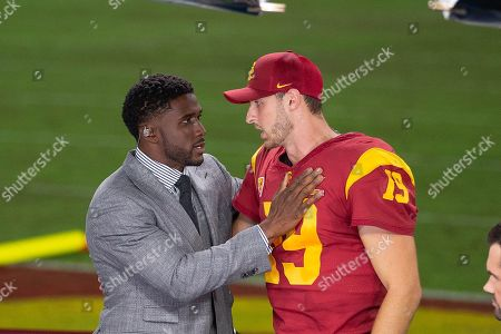 Los Angeles, CA...USC quarterback (19) Matt Fink gets congratulated by former USC running back Reggie Bush after a game between the Utah Utes vs USC Trojans. USC defeated Utah 30-23 on at the United Airlines Field at the Los Angeles Memorial Coliseum, in Los Angeles, California. (Mandatory Credit: Juan Lainez / MarinMedia.org / Cal Sport Media) (Complete photographer, and credit required)