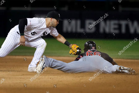 Yolmer Sanchez, Yasiel Puig. Cleveland Indians' Yasiel Puig steals second ahead of the tag by Chicago White Sox second baseman Yolmer Sanchez during the sixth inning of a baseball game, in Chicago