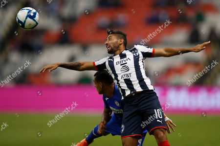 Monterrey's Jonathan Urretaviscaya, front, and Cruz Azul's Yoshimar Yotun fight for the ball during a Mexican soccer league match at Azteca stadium in Mexico City