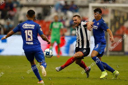 Monterrey's Vincent Janssen, center, goes for the ball between Cruz Azul's Igor Lichnovsky, right, and Yoshimar Yotun during a Mexican soccer league match at Azteca stadium in Mexico City