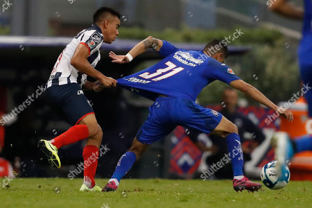 Monterrey's Carlos Rodriguez, left, and Cruz Azul's Orbelin Pineda fight for the ball during a Mexican soccer league match at Azteca stadium in Mexico City