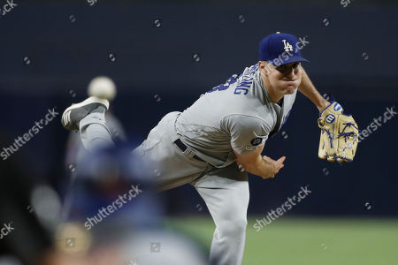 Stock Picture of Los Angeles Dodgers starting pitcher Ross Stripling works against a San Diego Padres batter during the first inning of a baseball game, in San Diego