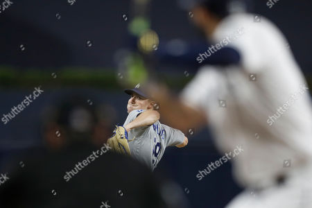 Los Angeles Dodgers starting pitcher Ross Stripling works against a San Diego Padres batter during the first inning of a baseball game, in San Diego