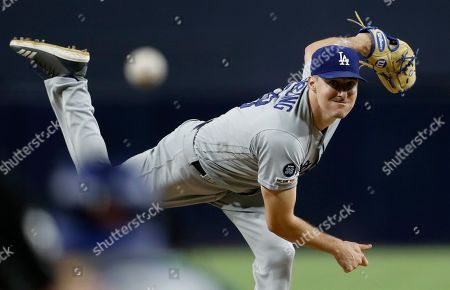 Stock Photo of Los Angeles Dodgers starting pitcher Ross Stripling works against a San Diego Padres batter during the first inning of a baseball game, in San Diego