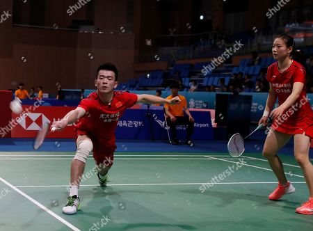 Zheng Si Wei (L) and Huang Ya Qiong (R) of China in action against Gabrielle Adcock and Chris Adcock (not pictured) of Britain during the Mixed Doubles round two match of the Korea Open 2019 badminton championships in Incheon, South Korea, 26 September 2019.