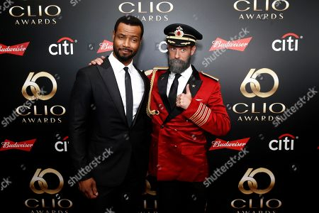 Brandon Moynihan, Isaiah Mustafa. Isaiah Mustafa and Brandon Moynihan on the red carpet before the 60th Annual Clio Awards at The Manhattan Center on in New York