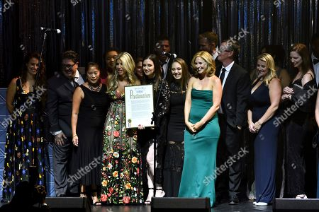 Clio President Nicole Purcell and her staff are presented a proclamation by the commissioner of the New York City Mayor's Office of Media and Entertainment, Anne del Castillo at the 60th Annual Clio Awards at The Manhattan Center, in New York