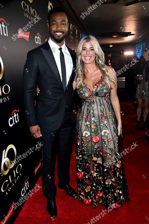 Isaiah Mustafa and Clio President Nicole Purcell on the red carpet at the 60th Annual Clio Awards at The Manhattan Center, in New York