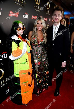From left, Billie Eilish, Clio President Nicole Purcell, and Finneas O'Connell on the red carpet at the 60th Annual Clio Awards at The Manhattan Center, in New York